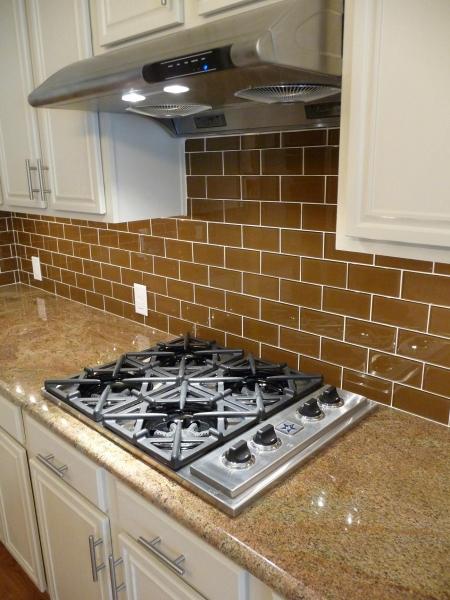 photo 3x6 glass tile backsplash with juparana arandis granite