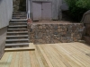Blue stone steps with fieldstone retaining wall