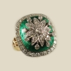 Immensely pleasing to the eye, this large and beautiful antique cocktail ring has approximately 1.3 carats of diamonds set in green enameled 14k yellow gold.