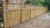 Solid board wood privacy fence with lattice topper