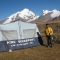 Trekking guide edgar zambrano and group tent in east side of ausanate mountain  - cusco ausangate 14 days trek