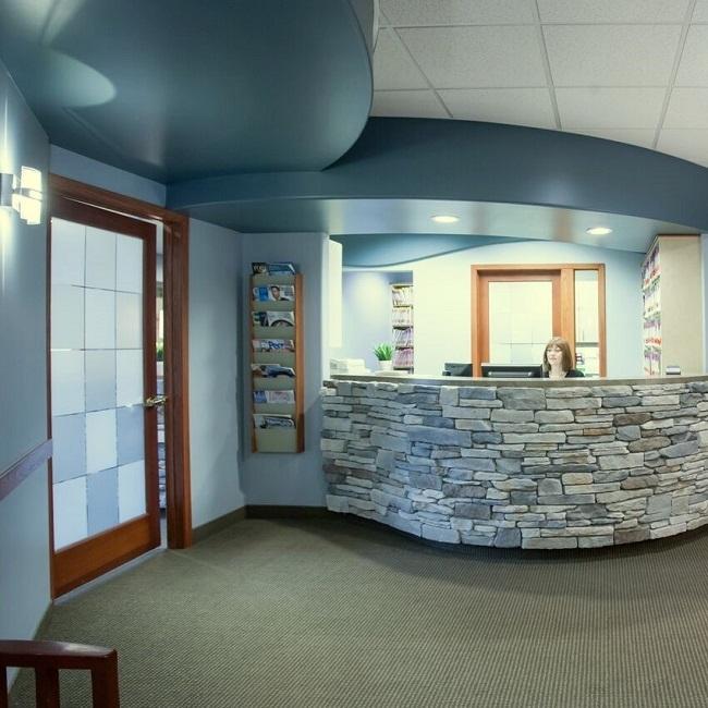 frontdesk at the family dentistry office of Dr. Max Molgard Spokane WA