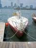 J24 - club sailboat (red hull boats are usually used by the school)