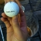 """""""long & soft"""" golf ball over a pitcher of budweiser."""