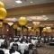 Gold and black balloon decorations for event