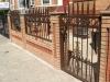 Customized decorative perimeter fence w/ entrance gate