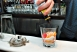 """Cristian at the bar makes the best """"Old Fashioned"""" in NYC!"""