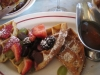 Sour cream and hazelnut waffles with mixed berries and bourbon maple syrup
