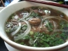 Pho with good broth -- but thickly sliced meat and no bean sprouts! note the slice of ox tail.
