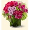 Sophiticated & rich combination of roses, tulips, orchids & hydrangeas